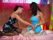 Two winsome lesbians in stockings stripping and touching their sexy bodies